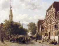 A busy market in Veere with the bell-tower of the town hall beyond