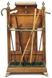 A LATE VICTORIAN OAK AND BRASS-MOUNTED HALL STAND