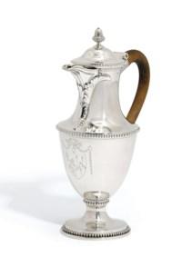 A GEORGE III SILVER HOT-WATER JUG