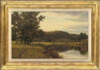 Cattle grazing by a river
