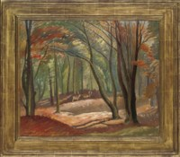 Deer in an autumnal wooded landscape