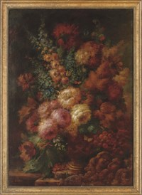 Roses, peonies and delphiniums in a vase, on a stone ledge