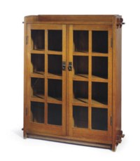 AN OAK AND GLASS BOOKCASE,