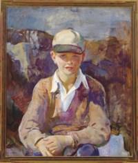 Portrait of a seated boy wearing a baseball cap