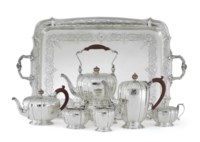 AN ELIZABETH II SILVER SIX-PIECE TEA AND COFFEE SERVICE AND TRAY