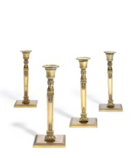A SET OF FOUR FRENCH EMPIRE SILVER-GILT CANDLESTICKS