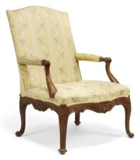 A GEORGE II CARVED SOLID WALNUT ARMCHAIR