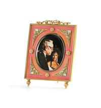 AN ENAMEL AND BI-COLORED GOLD PHOTOGRAPH FRAME, BY FABERGE