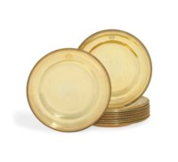 A SET OF TWELVE FRENCH EMPIRE SILVER-GILT DINNER-PLATES FROM THE BORGHESE SERVICE