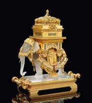 A FRENCH GILT-BRONZE, CRYSTAL