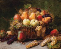 Pears, apples and grapes in a wicker basket on a stone ledge