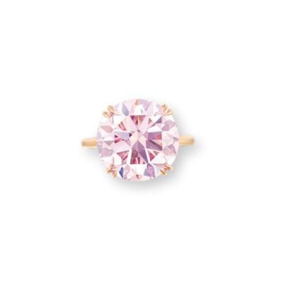 A COLOURED DIAMOND RING, BY HA