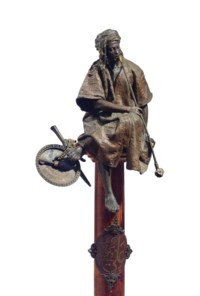 A FRENCH POLYCHROME-PATINATED METAL FIGURE ENTITLED 'LE FUMEUR', ON PEDESTAL