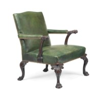 A GEORGE II-STYLE MAHOGANY LIBRARY ARMCHAIR