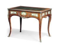 AN EARLY VICTORIAN PORCELAIN- AND ORMOLU-MOUNTED KINGWOOD AND TULIPWOOD BUREAU PLAT
