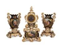 A FRENCH BLACK GROUND THREE PIECE PORCELAIN NEO-ROCOCO CLOCK GARNITURE,