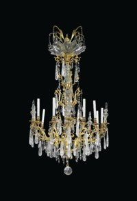 A FRENCH ORMOLU, CUT-GLASS AND ROCK CRYSTAL TEN-LIGHT CHANDELIER