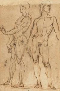 Two nude men standing