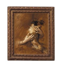 Woman holding a Pekingese Dog