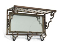 A RAYMOND SUBES (1893-1970) BRUSHED AND BRONZED STEEL, MIRRORED WALL MOUNTED COAT RACK