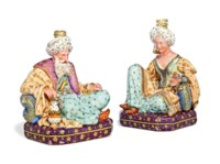 A PAIR OF JACOB PETIT FIGURAL FLASKS AND STOPPERS