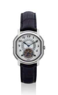 DANIEL ROTH. A FINE AND RARE 18K WHITE GOLD TONNEAU-SHAPED TOURBILLON WRISTWATCH WITH RETROGRADE DATE AND POWER RESERVE