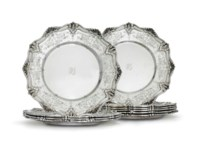 A SET OF NINE CANADIAN SILVER DINNER PLATES