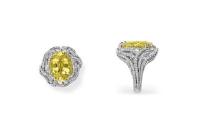 A YELLOW BERYL AND DIAMOND RIN