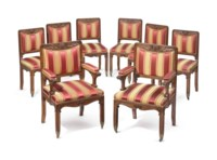 A SET OF EIGHT AESTHETIC MOVEMENT CARVED OAK DINING CHAIRS