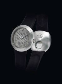 IKEPOD. A RARE AND UNUSUAL PLATINUM LIMITED EDITION AUTOMATIC WRISTWATCH