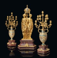 A FINE FRENCH ORMOLU, CHAMPLEVE ENAMEL AND ROUGE GRIOTTE MARBLE THREE-PIECE CLOCK GARNITURE