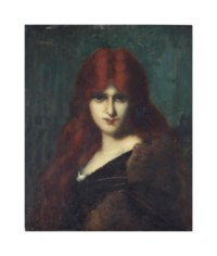 Portrait of a beauty with long red hair