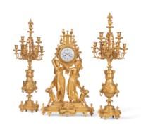A FRENCH ORMOLU THREE-PIECE CLOCK GARNITURE