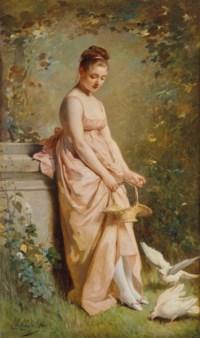 Jeune femme agrainant des colombes