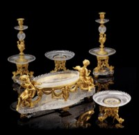 A FRENCH ORMOLU AND CUT-GLASS FIVE-PIECE TABLE GARNITURE