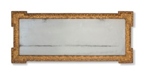 A GEORGE II GILTWOOD AND GESSO MIRROR