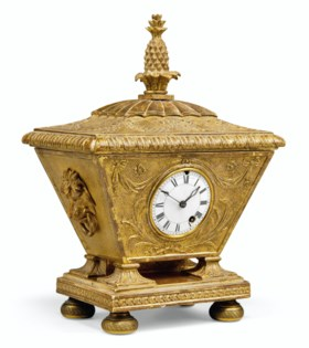 A REGENCY GILTWOOD AND GESSO TIMEPIECE TABLE CLOCK