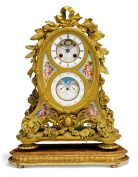 A VICTORIAN ORMOLU AND PORCELAIN STRIKING MANTEL CLOCK WITH